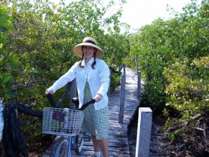 Lisa with bicycle and mangroves