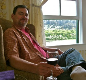 Clark with wine at window