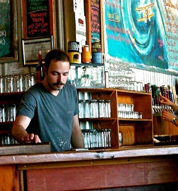 bartender with handlebar mustache