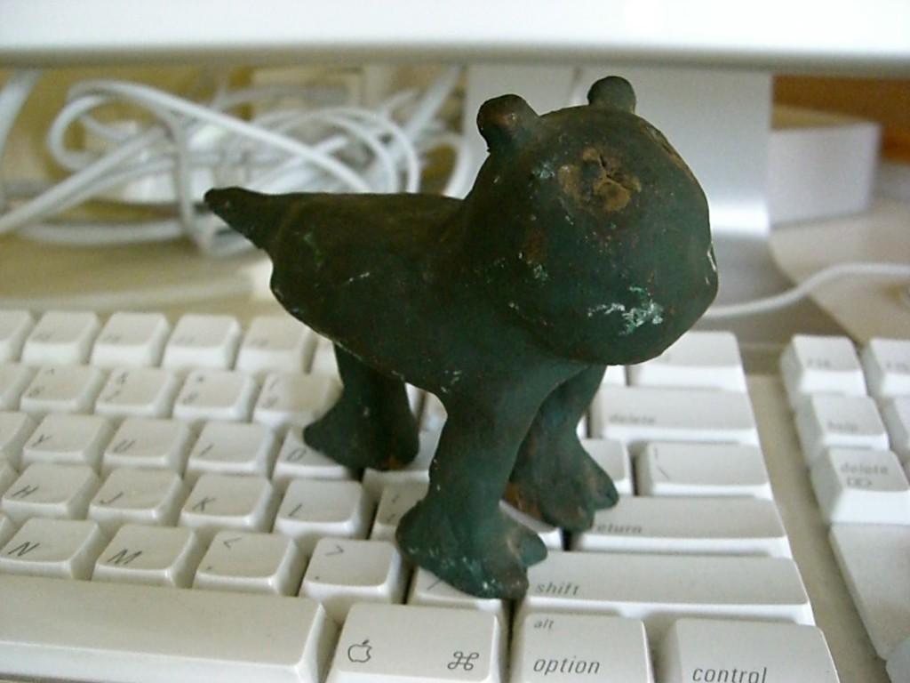 clay idol on keyboard