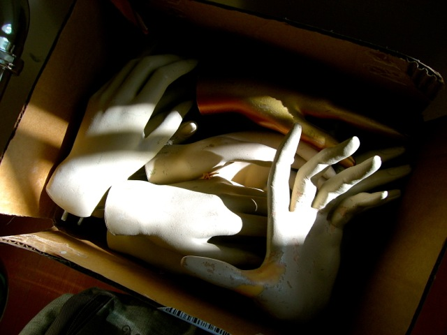 box of mannequin hands
