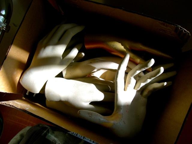 box of mannequin hands