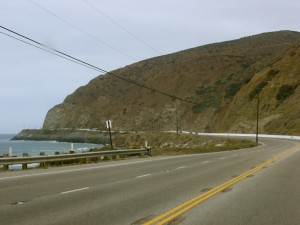Traffic thins out. The coast is so very brown and bare here; there are cactus on the hillsides.