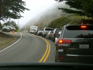 Stopped for road construction. I was grateful that the mist hid the view over the edge of the road. Gah.