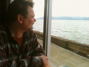 Clark ponders the river, and speaks of the sturgeon he once caught.