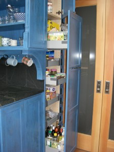 Pull-out pantry. Stores heaps of stuff. Ikea, of course… as is the open cabinet you see to the left. I had our builder add the corbel and trim to gussy it up.