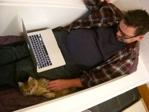 My husband Clark in the tub with Snorri.